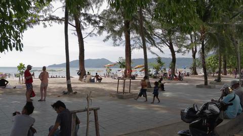 Kids Walking At Patong Beach Promenade stock footage