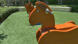 Seesaw In The Shape Of The Horses For The Playground stock footage
