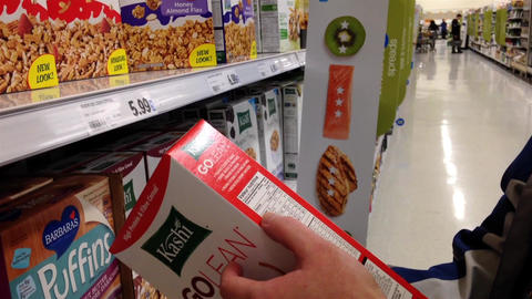 Man checking cereal ingredient in grocery store Live Action