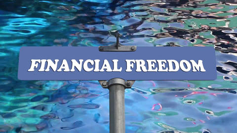 Financial Freedom Road Sign With Blue Water Wave Background stock footage