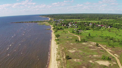 Flying Above Shore Lake stock footage