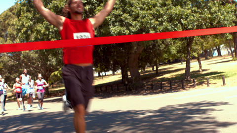 In high quality format fit people running race in park Footage