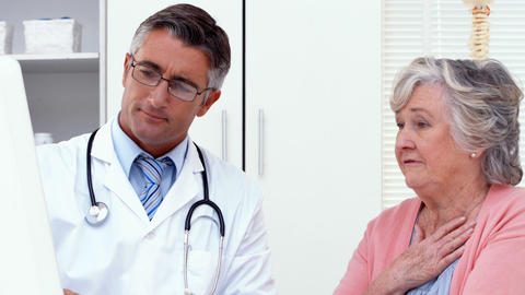Doctor explaining something to his patient Footage