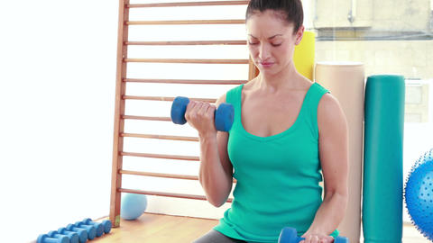 Young woman exercising with dumbbells Footage