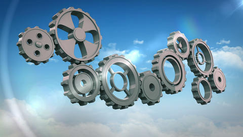 Cogs and wheels turning against blue sky Animation