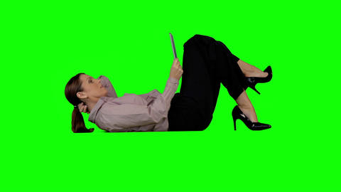 Businesswoman using tablet against green screen Animation