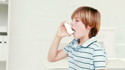 Boy using inhaler Footage
