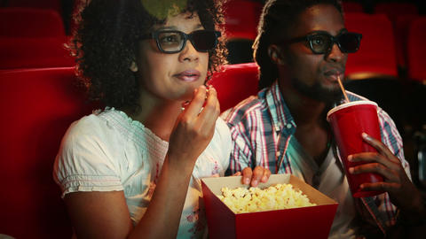 Happy couple watching scary 3d movie Footage