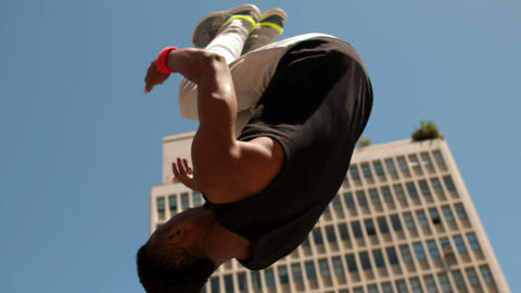 Handsome young man doing backflip Live Action