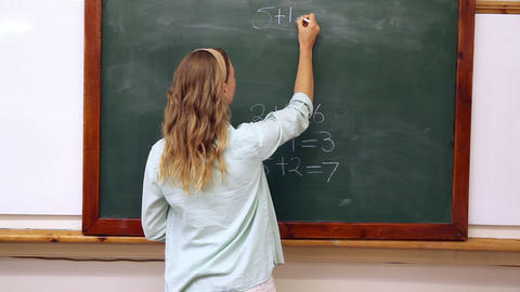 Teacher writing mathematics on board Footage