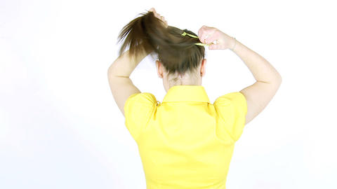 Girl making ponytail with her long silky hair Stock Video Footage