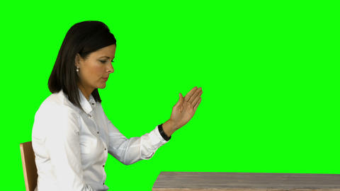 Irritated businesswoman sitting on chair on green screen Footage
