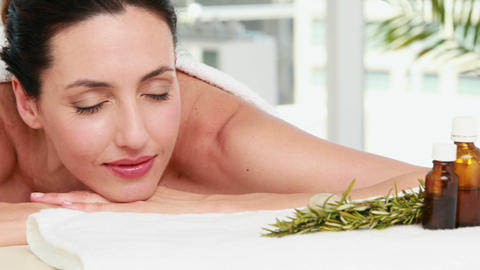 Smiling woman getting an aromatherapy treatment Live Action