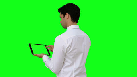 Businessman using his tablet pc Live Action