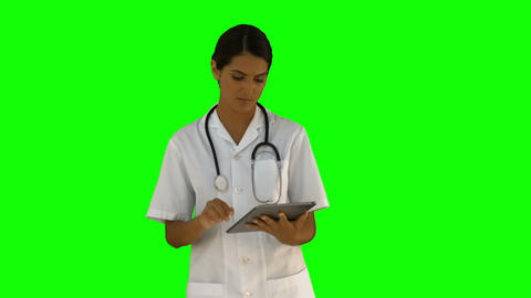 Nurse using her tablet pc Live Action