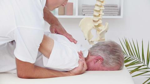 Doctor Massaging His Patient Shoulder stock footage