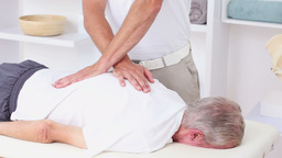 Doctor Massaging His Patients Back stock footage
