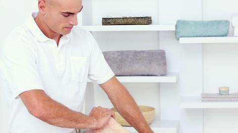 Doctor Massaging His Patients Calf stock footage