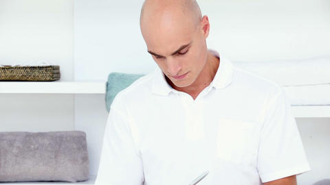 Doctor Writing On Notepad stock footage