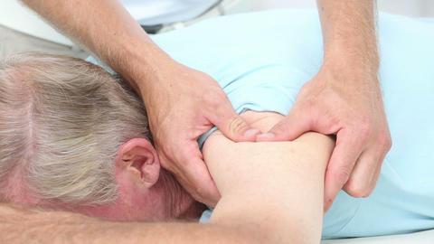 Doctor Massaging His Patients Shoulder stock footage
