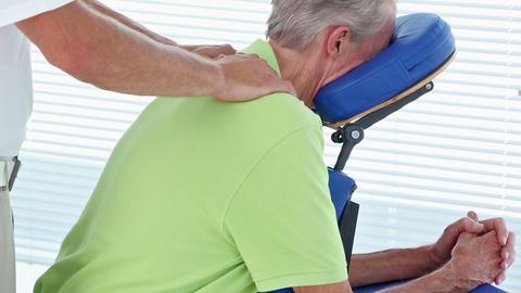 Doctor Massaging His Patients Shoulders stock footage