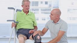 Doctor Examining His Patients Knee stock footage