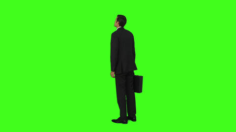 Businessman standing with his briefcase Footage