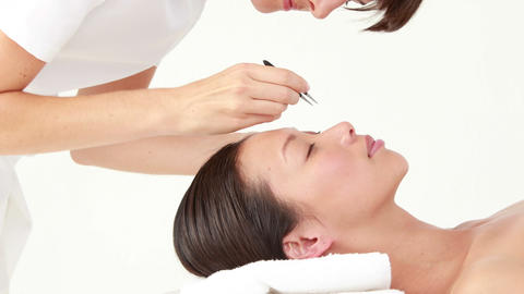 Woman getting her eyebrows shaped Footage