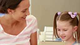 Mother And Daughter Using Tablet Computer Together stock footage