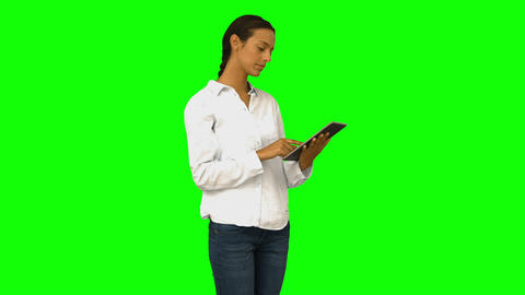 Casual woman using her tablet pc Live Action
