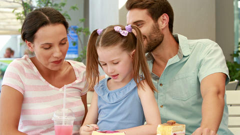 Happy Family Enjoying Lunch In A Restaurant stock footage