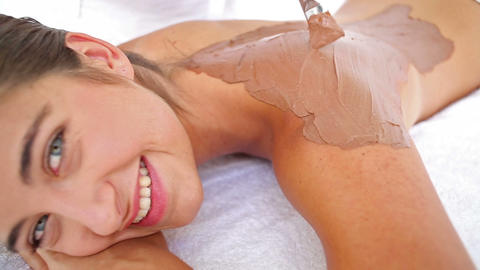 Beautiful brunette enjoying a chocolate beauty treatment Footage
