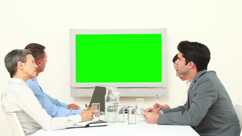 Business Team Looking At White Screen And Talking stock footage