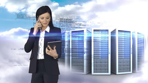 Businesswoman having phone call and holding tablet computer in front of server tower Animation