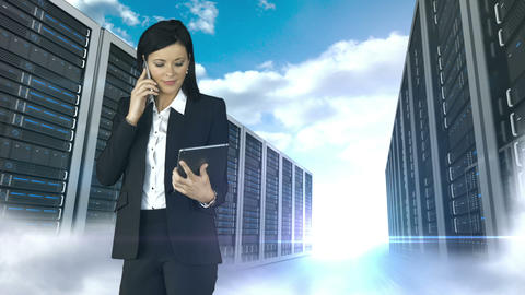 Businesswoman having phone call and holding tablet computer in server tower store Animation