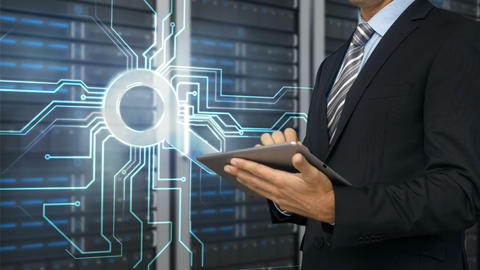 Businessman using tablet computer in front of server tower Animation