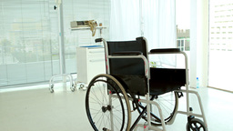 Black wheelchair in medical bedroom Footage
