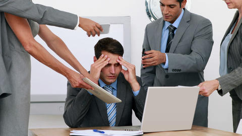 Anxious businessman sitting with hands on head Footage