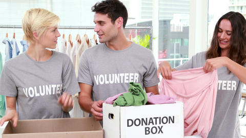 Volunteers friends holding donation boxes Footage