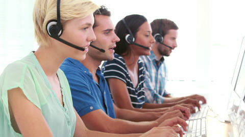 Happy call centre agents talking on the headset Footage