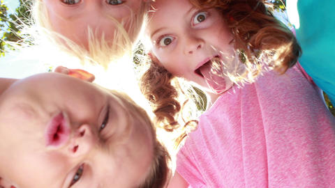 Happy children grimacing in front of camera Footage
