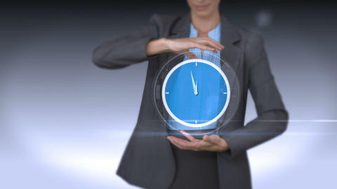 Businesswoman holding virtual alarm clock Footage