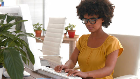 Serious casual businesswoman using computer Live Action