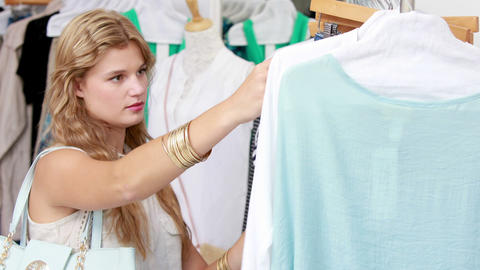 Pretty blonde shopping for clothes Footage