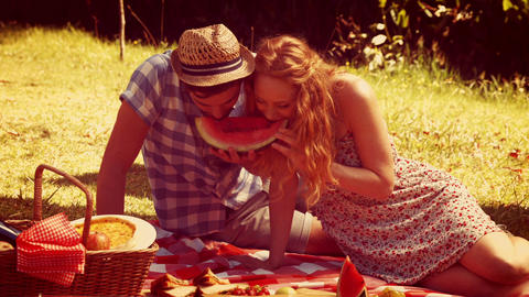 Young couple on a picnic eating watermelon Footage