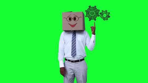 Businessman with a carton on the head pointing at animated grears Footage
