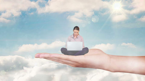 Hand holding sitting businesswoman focused on laptop against blue sky Animation