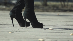 Female Legs In Boots And Pigeons On The Sidewalk stock footage
