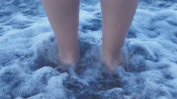Woman stands on the sea beach Footage