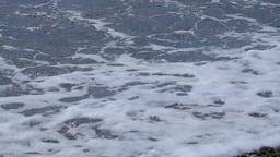 Sea waves rolls on the pebble beach Footage